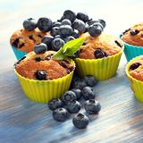 Muffin with blueberries on a wooden table. fresh berries and swe. Et pastries on the board royalty free stock photo