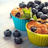 Muffin with blueberries on a wooden table. fresh berries and swe. Et pastries on the board stock photography