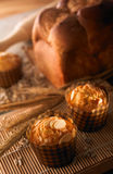 Muffin and bread. Muffin bread and wheat with table top setting royalty free stock images