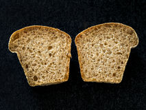 Muffin bread sliced in two halves Stock Images
