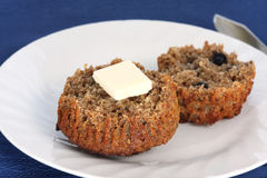 Muffin with butter royalty free stock photography