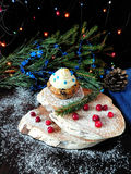 Muffin with butter cream. Surrounded by Christmas decorations royalty free stock images