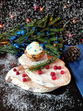 Muffin with butter cream. Surrounded by Christmas decorations stock photography