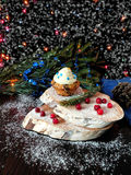 Muffin with butter cream. Surrounded by Christmas decorations stock photos