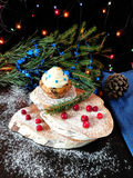 Muffin with butter cream. Surrounded by Christmas decorations royalty free stock image