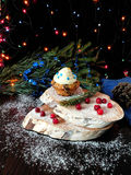 Muffin with butter cream. Surrounded by Christmas decorations royalty free stock photography