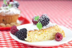 Muffin , cake with icing and berries Stock Photo