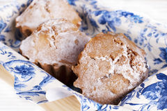 Muffin cakes on a blue tablecloth Stock Photos