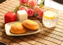 Muffin cakes and cold lemonade with ice placed Stock Images
