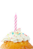 Muffin with candle. A tasty muffin with candle isolated on white background. Shallow DOF Stock Image