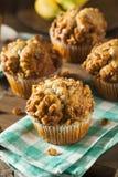 Muffin casalinghi del dado della banana Immagine Stock