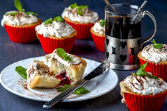 Muffin with cherry and pineapple on white plate Stock Image