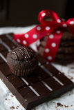 Muffin and chocolate chip cookie with chocolate bar and red silk bow with white dots Stock Photos