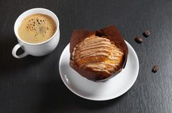 Muffin with cream and coffee royalty free stock photo