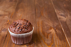 Muffin chocolate on dark wood table Royalty Free Stock Image