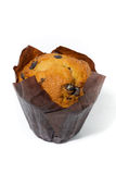 Muffin with chocolate drops on a white background Stock Photography