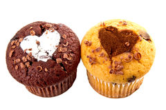 Muffin with chocolate and hearts. Two Muffin with chocolate and hearts Stock Photography