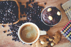Muffin chocolate and hot coffee. On table Royalty Free Stock Photography