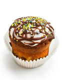 Muffin with chocolate icing and colored sugar top Stock Images