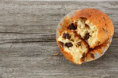 Muffin with chocolate on old wooden table. top view Royalty Free Stock Images
