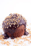 Muffin with chocolate sauce and hazelnut. On a white background Stock Photo