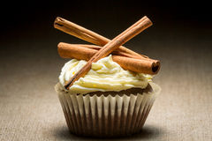 Muffin with cinnamon bark and cream Stock Image