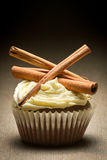 Muffin with cinnamon bark and vanilla cream Royalty Free Stock Images