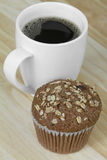 Muffin and Coffee. Oat bran muffin with freshly brewed coffee Royalty Free Stock Image