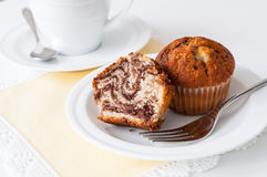 Muffin coffee break. A piece of cut marble muffin with coffee cup Stock Photos
