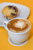 Muffin and coffee latte Stock Images