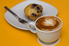 Muffin and coffee latte Stock Image