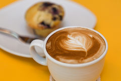 Muffin and coffee latte Royalty Free Stock Image
