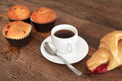 Muffin and coffee. Muffins and coffee cup on a dark wooden table Stock Images