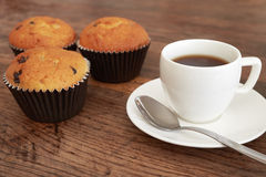 Muffin and coffee. Muffins and coffee cup on a dark wooden table Royalty Free Stock Photos