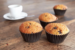 Muffin and coffee. Muffins and coffee cup on a dark wooden table Stock Photo