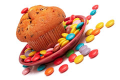 Muffin and colorful sweet candies. Stock Photos
