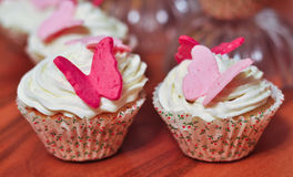 Muffin con la farfalla Fotografia Stock