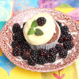 Muffin with cream Stock Images