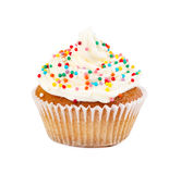 Muffin with cream, decorated colorful candy sprinkles Stock Photo