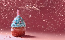Muffin with cream and extinguished candle. the concept of the en. D of the celebration Stock Images