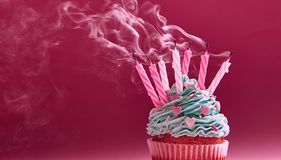 Muffin with cream and extinguished candle. the concept of the end of the celebration.  Royalty Free Stock Images