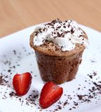Muffin with cream and strawberries Royalty Free Stock Images