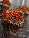 Muffin with cream in wafer crumbs and jelly worms Stock Image