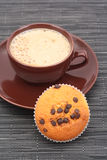 Muffin and cup of coffee Royalty Free Stock Image