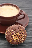Muffin and cup of coffee Royalty Free Stock Photos