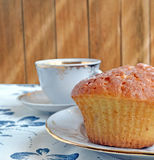Muffin and a cup of coffee on a table close up Stock Photos