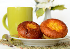 Muffin with a cup of tea. Yoghurt muffin with a cup of tea on the table Royalty Free Stock Image