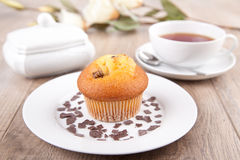Muffin with a cup of tea Stock Photos