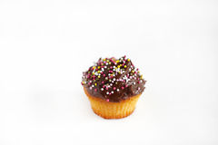 Muffin or cupcake with chocolate ganache and sprinkles Royalty Free Stock Images