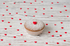 Muffin decorated with red hearts Stock Photography